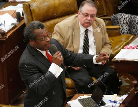 Tommy Taylor, Willie Perkins Rep. Willie Perkins, D-Greenwood, left, questions House Education Committee chairman John Moore, R-Brandon, about the Teacher Pay Raise bill, as Rep. Tommy Taylor, R-Boyle, listens during debate on chambers floor at the Capitol in Jackson, Miss., . Representatives voted 86-26 to pass House Bill 504. Teachers would get a $1,500 raise over the next two years, and a projected raise of $2,750 over the following two years, assuming state revenues continue growing. Teachers in their first five years would get raises automatically while those with more than five years' experience would have to meet three of 22 criteria