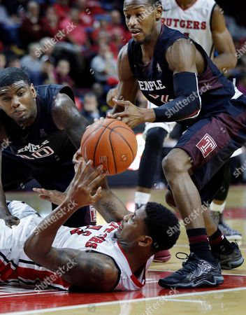 Mark Williams, Will Cummings, Craig Brown Temple forward Mark Williams (10) and Temple guard Will Cummings (2) try to make a steal as Rutgers guard Craig Brown (15) lands on his back during the second half of an NCAA college basketball game against Temple in Piscataway, N.J., . Rutgers won 71-66