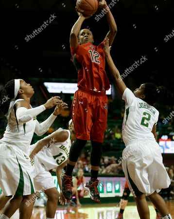 Stock Image of Odyssey Sims, Nina Davis, Niya Johnson, Amber Battle Texas Tech guard Amber Battle (12) goes up for a shot as Baylor's Odyssey Sims, left, Nina Davis (13) and Niya Johnson (2) defend in the first half of an NCAA college basketball game, in Waco, Texas. Battle lead her team in scoring with 11-points in the 92-43 loss to Baylor