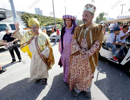 "Gabriel Lopez, Salvador Cajete, Oscar Vasquez Dressed as the Three Wise Men, Oscar Vasquez, right, Salvador Cajete, center, and Gabriel Lopez, left, are shown before the start of the Three Kings Day Parade, in Miami. The parade which honors the Three Wise Men, travelled down ""Calle Ocho,"" in Miami's Little Havana neighborhood"