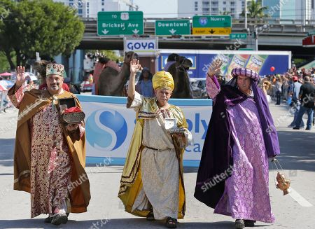 "Gabriel Lopez, Salvador Cajete, Oscar Vasquez Dressed as the Three Wise Men, Oscar Vasquez, left, Gabriel Lopez, center, and Salvador Cajete, march in the Three Kings Day Parade, in Miami. The parade which honors the Three Wise Men, travelled down ""Calle Ocho,"" in Miami's Little Havana neighborhood"