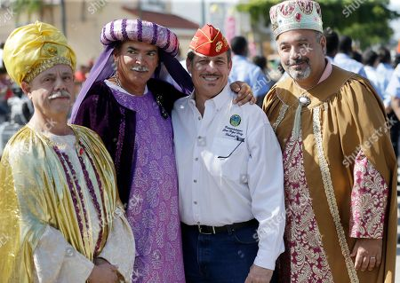 "Stock Picture of Gabriel Lopez, Salvador Cajete, Oscar Vasquez, Jose ""Pepe"" Diaz Miami-Dade County Commissioner Jose ""Pepe"" Diaz, second from right, poses with men dressed as the Three Wise Men, Oscar Vasquez, right, Salvador Cajete, second from left, and Gabriel Lopez, left, before the start of the Three Kings Day Parade, in Miami. The parade which honors the Three Wise Men, travelled down ""Calle Ocho,"" in Miami's Little Havana neighborhood"