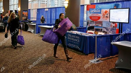 Katherine Lamers Katherine Lamers, of Dallas, Texas, with Housing Headquarters, carries supplies past the Oklahoma Insurance Department booth as vendors set up for the National Tornado Summit in Oklahoma City, . About 85 percent of residents who were displaced by the large and deadly tornadoes that decimated Joplin, Mo., and Moore, Okla., have rebuilt or intend to, the communities' mayors said Monday