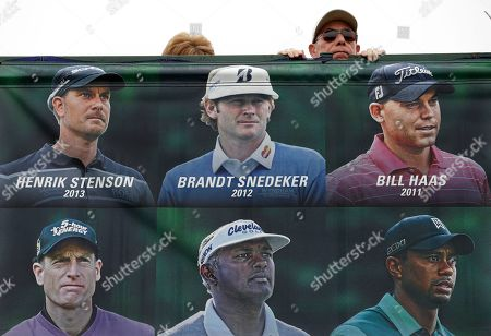 Stock Photo of Javier Soto looks over an image of past FedEx Cup winners during the second round of the Farmers Insurance Open golf tournament, in San Diego