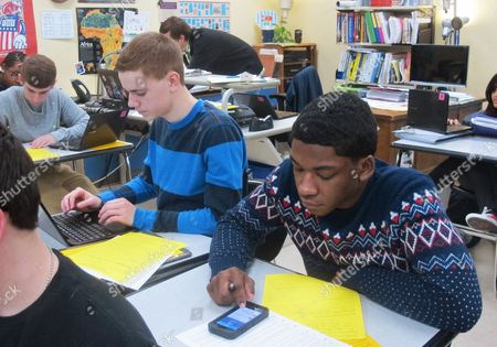 Hunter Waslicki, left, and Julian Barnes, rightt, log onto Twitter for a classroom exercise at Wauwatosa West High School in Wauwatosa, Wis. While many school officials frown upon the use of social media in the classroom, an increasing number of teachers see Twitter as a way to expand a classroom discussion to include diverse viewpoints from students around the country