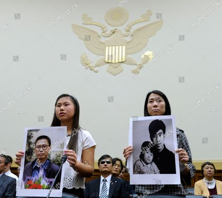 "Stock Photo of Bridgette Chen, Danielle Wang Bridgette Chen, left, holding photo of her father Liu Xianbing, and Danielle Wang, holding photo of her father Wang Zhiwen, are introduced on Capitol Hill in Washington, prior to testifying before the House Foreign Affairs Committee hearing entitled: ""Their Daughters Appeal to Beijing: 'Let Our Fathers Go"