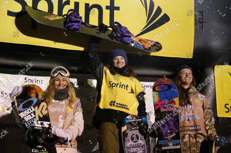 Stock Image of From left, Gretchen Bleiler, Kelly Clark and Arielle Gold, all of the United States, stand on the podium after competing in the U.S. Grand Prix halfpipe snowboarding finals, in Frisco, Colo. Clark took first place in the event, followed by Gold and Bleiler