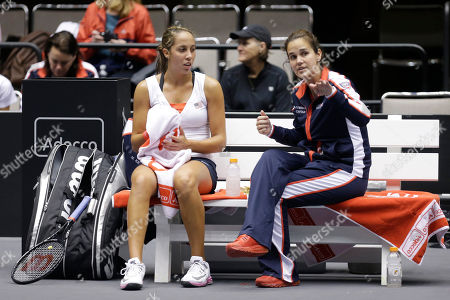 Christina McHale, Mary Joe Fernandez United States' Christina McHale, left, talks with coach Mary Joe Fernandez during a Fed Cup world group tennis match against Italy, in Cleveland