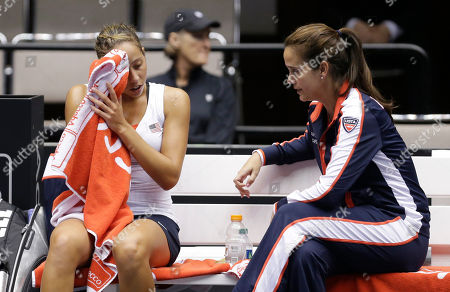 Madison Keys, Mary Joe Fernandez United States' Madison Keys, left, talks with coach Mary Joe Fernandez during a Fed Cup world group tennis match against Italy, in Cleveland. Italy's Camila Giorgi defeated Keys in two sets