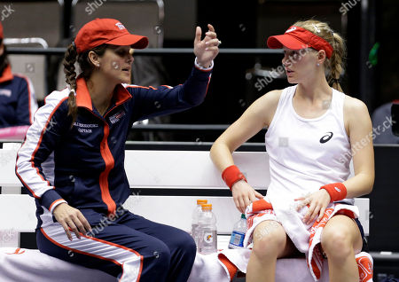 Mary Joe Fernandez, Alison Riske United States' Alison Riske, right, talks with coach Mary Joe Fernandez during a Fed Cup world group tennis match against Italy's Karin Knapp, in Cleveland. Knapp defeated Riske 6-3, 7-5