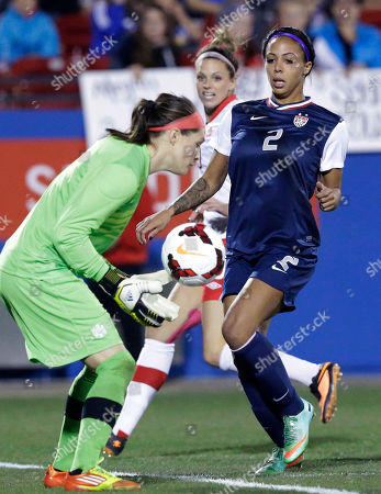 Stock Image of Sydney Leroux, Lauren Sesselmann, Erin McLeod U.S. forward Sydney Leroux (2) closes in on Canada goalkeeper Erin McLeod (1) with Canada defender Lauren Sesselmann (10) giving chase during the first half of a soccer game, in Frisco, Texas. The United States won 1-0