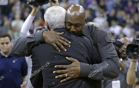 Stock Picture of Karl Malone, Jerry Sloan Former Jazz player Karl Malone, right, hugs former Jazz coach Jerry Sloan following a banner ceremony honoring Jerry Sloan at the EnergySolutions Arena, in Salt Lake City