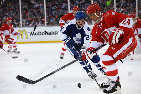 Bryan McCabe, Chris Chelios Toronto Maple Leafs defenseman Bryan McCabe closes in on Detroit Red Wings defenseman Chris Chelios during the first period of the Winter Classic alumni outdoor NHL hockey game at Comerica Park in Detroit