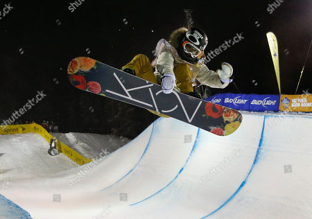 Gretchen Bleiler, of the United States, flies above the lip during the World Cup U.S. Grand Prix halfpipe snowboarding finals, in Frisco, Colo. Bleiler took third place in the event