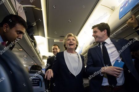Hillary Clinton, Varun Anand, Nick Merrill, Brian Fallon Democratic presidential candidate Hillary Clinton, accompanied by press aid Varun Anand, left, National Press Secretary Brian Fallon, second from left, and Traveling Press Secretary Nick Merrill, right, smiles as she walks back to the back of the plane to speak to members of the media while aboard her campaign plane at Lambert St. Louis International Airport in St. Louis,  following the second presidential debate at Washington University