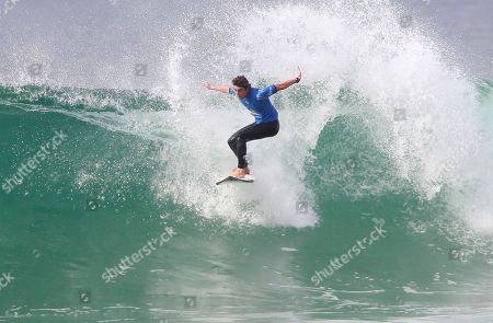 The Italian pro surfer Leonardo Fioravanti catches a wave at the 3th round of the men's qualifying series at the Quiksilver and Roxy Pro France surf competition in Hossegor, southwestern France, . The competition runs from Oct. 4 to Oct. 15