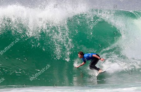 The Italian pro surfer Leonardo Fioravanti rides a wave at the 3th round of the men's qualifying series at the Quiksilver and Roxy Pro France surf competition in Hossegor, southwestern France, . The competition runs from Oct. 4 to Oct. 15