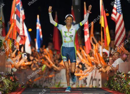 Stock Picture of Turia Pitt Bush fire survivor Turia Pitt, of Australia, finishes the Ironman World Championship Triathlon, in Kailua-Kona, Hawaii