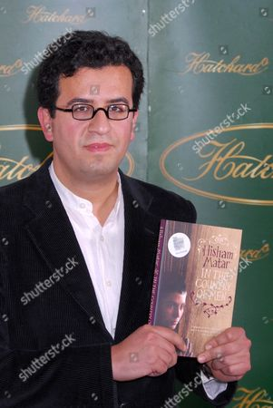 Hisham Matar with his book 'In the Country of Men'