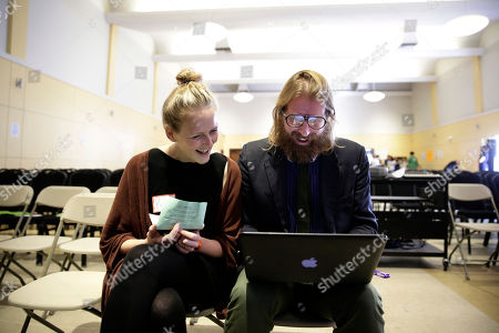 """Sanderson Jones, Pippa Evans British comedians and co-founders of the Sunday Assembly, Sanderson Jones, right, and Pippa Evans smile as they go over their presentation before the Sunday Assembly, in Los Angeles. Dozens of gatherings dubbed """"atheist mega-churches"""" by supporters and detractors are springing up around the U.S. after finding success in Great Britain earlier this year. The movement fueled by social media and spearheaded by the two prominent British comedians is no joke"""