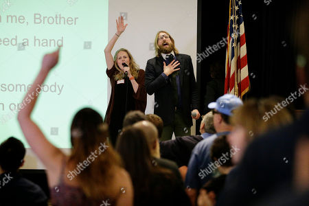 Sanderson Jones, Pippa Evans British comedians and co-founders of the Sunday Assembly, Sanderson Jones, right, and Pippa Evans sing a song at the Sunday Assembly, in Los Angeles. A new mega-church movement is generating buzz from London to Los Angeles, but this time it's a belief in non-belief that's drawing crowds on Sunday mornings. Sunday Assembly began in London in January and soared in popularity among atheists looking for a place to air their views with other likeminded people and now the concept has taken hold across the pond