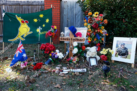A memorial to slain Australian baseball player Chris Lane is still in place in Duncan, Okla, . Prosecutors filed the upgraded charge on Wednesday to first-degree murder against 17-year-old Michael Dewayne Jones, who initially faced lesser charges in the August death of Christopher Lane, 22, of Melbourne, Australia. The other two suspects, Chancey Allen Luna and James Francis Edwards Jr., who are both 16, had already been charged as adults with first-degree murder