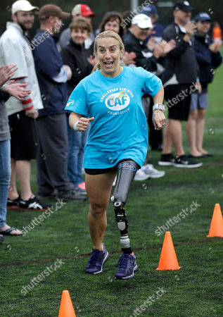 Sarah Reinertsen Triathlete Sarah Reinertsen, of San Juan Capistrano, Calif., smiles as she completes an obstacle course during a running clinic for challenged athletes, in Cambridge, Mass. The clinic was run by the Challenged Athletes Foundation, which provides equipment and training for amputees to participate in sports
