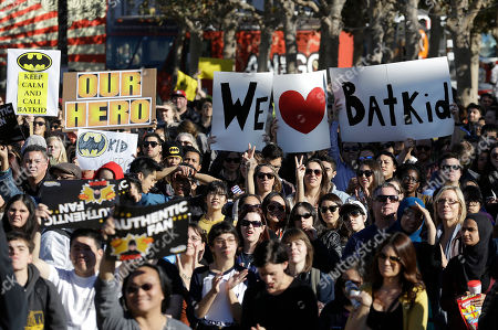 """A crowd holds up signs for Miles Scott, as Batkid, at a rally outside of City Hall in San Francisco, . Scott was called into service on Friday morning by San Francisco Police Chief Greg Suhr to help fight crime, as San Francisco turned into Gotham City as city officials helped fulfill the 5-year-old leukemia patient's wish to be """"Batkid,"""" The Greater Bay Area Make-A-Wish Foundation says. He was diagnosed with leukemia when he was 18 months old, finished treatment in June and is now in remission, KGO-TV reported"""