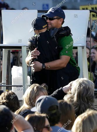 """Miles Scott, dressed as Batkid, hugs his father Nick at a rally outside of City Hall in San Francisco, . Miles Scott was called into service on Friday morning by San Francisco Police Chief Greg Suhr to help fight crime, as San Francisco turned into Gotham City as city officials helped fulfill the 5-year-old leukemia patient's wish to be """"Batkid,"""" The Greater Bay Area Make-A-Wish Foundation says. He was diagnosed with leukemia when he was 18 months old, finished treatment in June and is now in remission, KGO-TV reported"""