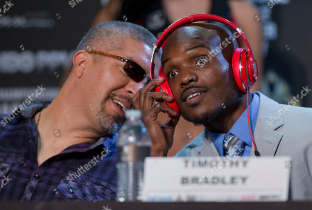 Timothy Bradley, Joel Diaz Timothy Bradley listens to a comment from his trainer, Joel Diaz, during news conference, in Las Vegas. Bradley and Juan Manuel Marquez face off for Bradley's WBO welterweight title on Saturday