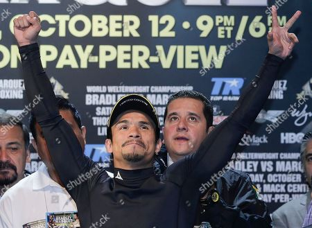 Juan Manuel Marquez Juan Manuel Marquez waves to boxing fans before weighing in for his WBO welterweight title fight against Timothy Bradley, in Las Vegas. Marquez will challenge Bradley for the title on Saturday