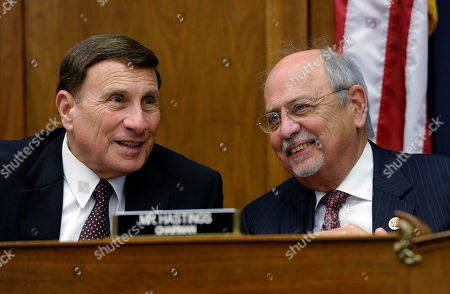 John Mica, Gerry Connolly House Natural Resources Committee Chairman Rep. Doc Hastings, R-Wash., right, talks with Rep. John Mica, R-Fla., left, during a joint hearing with the House Natural Resources Committee and the House Oversight and Government Reform Committee on Capitol Hill in Washington, . The hearing was looking at who was to blame for the closure of national parks because of the current government shutdown