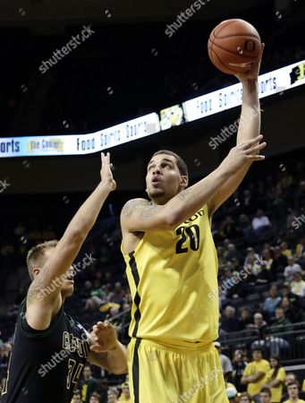 Waverly Austin, Brian Bennett Oregon center Waverly Austin, right, shoots over Cal Poly forward Brian Bennett during the first half of an NCAA college basketball game in Eugene, Ore