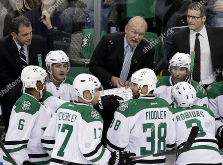 Trevor Daley, Rich Pevereley, Vernon Fiddler, Stephane Robidas, Lindy Ruff Dallas Stars head coach Lindy Ruff, top center, gives instructions from the bench to Shawn Horcoff (10), Trevor Daley (6), Rich Peverley (17), Vernon Fiddler (38) Stephane Robidas (3) and Erik Cole (72) as assistant coaches Curt Fraser, left rear, and James Patrick, right rear, look on in the final minutes of the third period of an NHL hockey game against the Washington Capitals, in Dallas. The Stars won 2-1