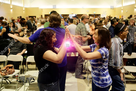 Heina Dadabhoy, left, one of the assembly's main speakers plays a game with an unidentified attendee at the Sunday Assembly, a godless congregation founded by British comedians Sanderson Jones and Pippa Evans,, in Los Angeles. A new mega-church movement is generating buzz from London to Los Angeles, but this time it's a belief in non-belief that's drawing crowds on Sunday mornings. Sunday Assembly began in London in January and soared in popularity among atheists looking for a place to air their views with other likeminded people and now the concept has taken hold across the pond