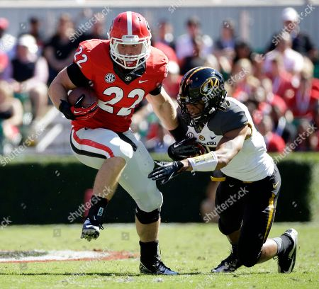 Georgia running back Brendan Douglas, left, battles Missouri's Matt White as he struggles for extra yardage during the first half of an NCAA college football game in Athens, Ga