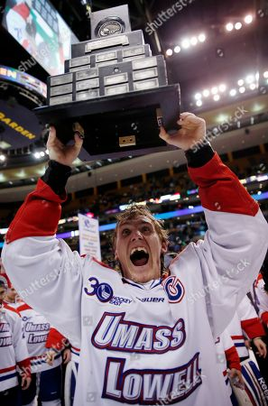 Josh Holmstrom Massachusetts-Lowell's Josh Holmstrom raises the trophy after the team defeated New Hampshire 4-0 in the Hockey East championship game in Boston
