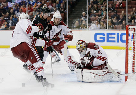 Mike Smith, Keith Yandle, Derek Morris, Corey Perry Phoenix Coyotes goalie Mike Smith (41) stops a shot in front of Coyotes' Keith Yandle (3), Derek Morris (53), and Anaheim Ducks' Corey Perry (10) during the second period of an NHL hockey game, in Anaheim, Calif