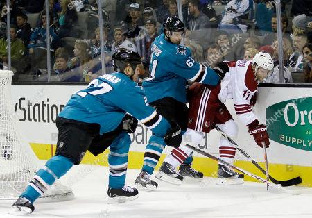 Radim Vrbata, Scott Hannan, Justin Braun Phoenix Coyotes' Radim Vrbata (17), of the Czech Republic, is defended by San Jose Sharks' Justin Braun (61) and Scott Hannan (27) during the second period of an NHL hockey game, in San Jose, Calif