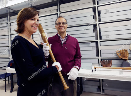 Joe Torre, Ali Torre Former New York Yankees manager Joe Torre and wife, Ali, hold a Babe Ruth bat during his orientation visit at the Baseball Hall of Fame, in Cooperstown, N.Y. Torre will be inducted to the hall in July