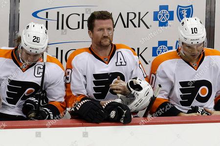 Claude Giroux, Scott Hartnell, Brayden Schenn Philadelphia Flyers left wing Scott Hartnell, center, sits between teammates Claude Giroux (28) and Brayden Schenn (10) in the third-period of an NHL hockey game against the Pittsburgh Penguins in Pittsburgh . The Flyers won 2-1
