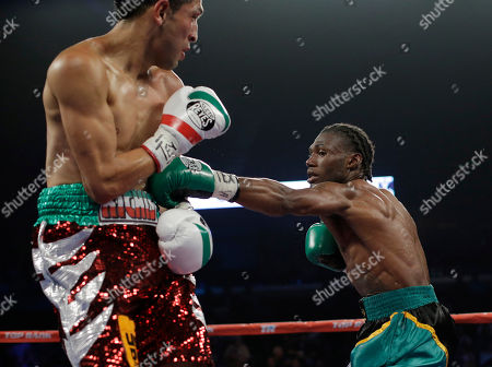 Alberto Garza, Nicholas Walters Nicholas Walters, right, lands a body punch on Alberto Garza, left, during round 3 of a WBO featherweight title bout, in Corpus Christi, Texas. Walters won with a knockout in the 4th round