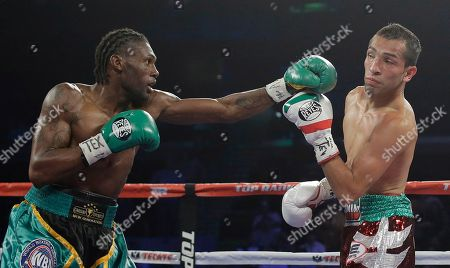 Alberto Garza, Nicholas Walters Nicholas Walters, left, throws a punch at Alberto Garza, right, during the second round of a WBO featherweight title bout, in Corpus Christi, Texas. Walters won with a knockout in the 4th round