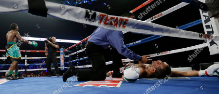 Alberto Garza, Nicholas Walters Alberto Garza, right, is down for the count as Nicholas Walters celebrates in the background during the 4th round of a WBO featherweight title bout, in Corpus Christi, Texas