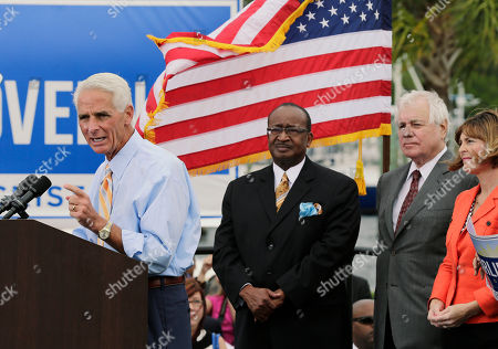 Charlie Crist, Kathy Castor, Bob Butterworth Former Republican Florida Gov. Charlie Crist gestures as supporters, including, U.S. Rep, Kathy Castor, D-Fla., right, and former Florida Attorney Gen. Bob Butterworth, second from right, look on during a campaign rally, in St. Petersburg, Fla. Crist announced that he is running again for governor, this time as a Democrat
