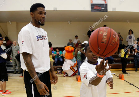 Udonis Haslem, Jamin Phillips Miami Heat forward Udonis Haslem, left, watches as Jamin Phillips,12, spins a basketball during a Veterans Day basketball clinic hosted by the Miami Heat at U.S. Southern Command, in Doral, Fla. About 150 children from military families attended the event