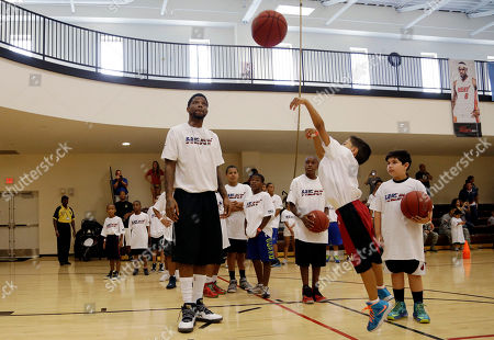 Udonis Haslem Miami Heat forward Udonis Haslem, left, watches as Sebastian Rios, 7, shoots a basket during a Veterans Day basketball clinic hosted by the Miami Heat at U.S. Southern Command, in Doral, Fla. About 150 children from military families attended the event