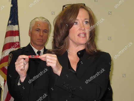 Kathleen Rice Nassau County District Attorney Kathleen Rice shows a tiny camera that allegedly was placed at a Long Island Rail Road station to steal commuters' financial information. The prosecutor and Metropolitan Transportation Officials annouced, in Mineola, N.Y., that four people have been arrested in the alleged skim scam. Standing behind the prosecutor is MTA Police Chief Michael Coan