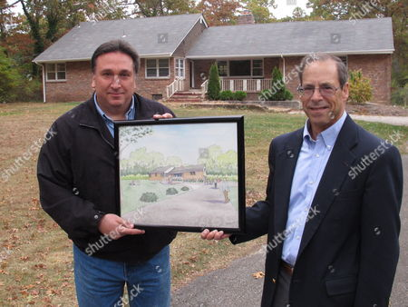 """Stock Image of Steve Fulgoni, left, and Ron Stein, two of the organizers of an effort to restore a home of jazz legend John Coltrane, hold an artist's rendering of the the Dix Hills, N.Y. site after restoration. This is where the saxophonist composed the epic 1964 jazz masterpiece """"A Love Supreme"""