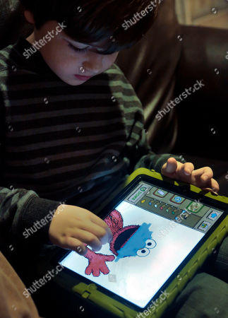 Stock Photo of Marc Cohen, 5, uses a Sesame Street app on his tablet at home in New York. Tablets of all types are expected to rank among the top holiday gifts for children this year, but some experts and advocates question the educational or developmental benefits for youngsters